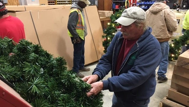The Mansfield Street Department with volunteers from IBEW Local 688 on Saturday will put up holiday wreaths downtown. Thirty-four new wreaths were purchased with a grant from Richland Foundation and Richland Gives.
