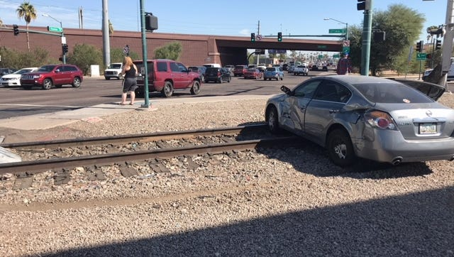 A car was T-boned by a BNSF Railway train at 27th Avenue and Thomas Road in Phoenix on November 1, 2017.