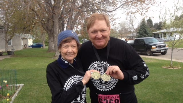Jay Baumberger and his mother, Joyce, posed after competing in the Ice Breaker Road Race in Great Falls. The former Great Falls High star quarterback died at 65 earlier this week.