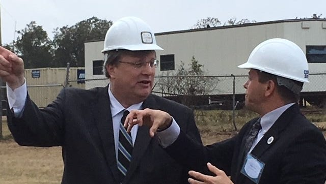 Memphis Mayor Jim Strickland talks with Public Works Director Robert Knecht at groundbreaking ceremonies for improvements to the T.E. Maxson Wastewater Treatment Facility.