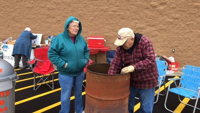 Pat and Wade Bell have been volunteering at Harmony House at 124 W. Third St., and its annual fundraiser Sleepout for the Homeless for 27 years. Friday, Wade Bell gets the fire barrel going to keep volunteers warm during the sleepout to raise awareness to the homeless in Richland County.