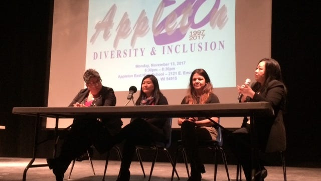 Past Appleton diversity coordinators, from left, Kathy Flores, Pa Lee Moua, Sarah Druckrey and Pam Her talk about their work Monday at an event at Appleton East High School.