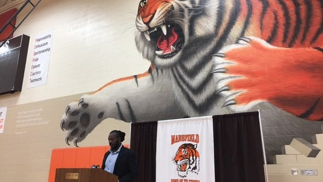 Christen Lee, a 2003 graduate of Mansfield Senior High School, talked Wednesday about a Basketball Classic being held Dec. 2 and 3 at Pete Henry gymnasium.