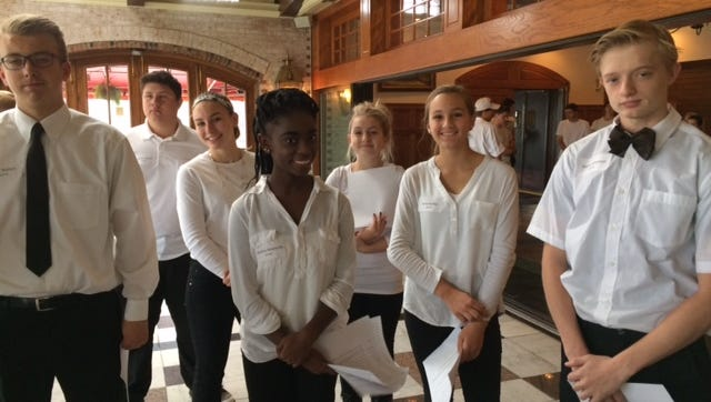 Oconomowoc High School students Keith Walters, Brannon Houck, Katie Kindler, Martina Newlands, Grace Hood, Oona Audley, and Seyter Holeman learn about front-of-house responsibilities before their hospitality class lunch service at Golden Mast.