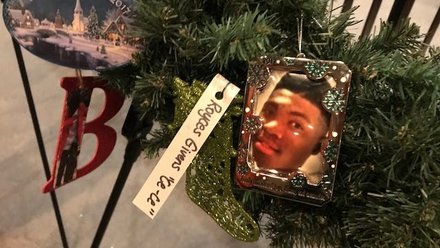 A photo of Terrance DeWayne Smith, who was fatally shot by another teenager when he was 16, adorns a wreath at Memphis City Hall. His mother, Antoinette Johnson Guy, placed it there in memory of him.