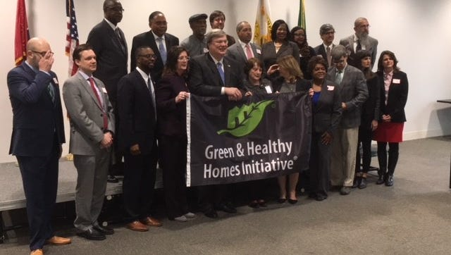 Memphis Mayor Jim Strickland and other local officials pose after signing an agreement to pursue the goals of the Green & Healthy Homes Initiative.