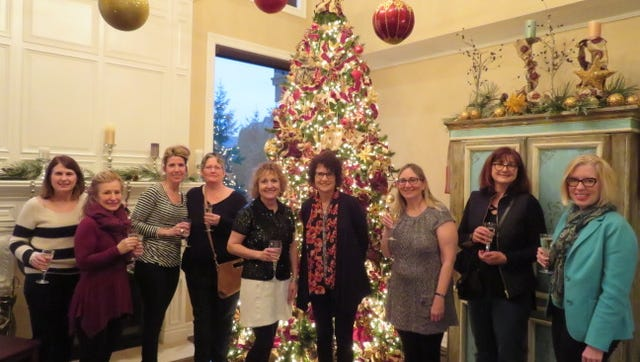 Many groups of friends made the Northville Holiday Home Tour their kickoff to the season.  This group celebrated the end of the tour at the home of Linda Rose, whose home was featured on the tour this year.