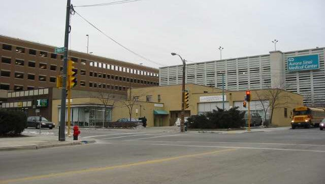 Two buildings in the 1200 block of W. Wells St. will be razed by Marquette University to create a parking lot and long-term development site.