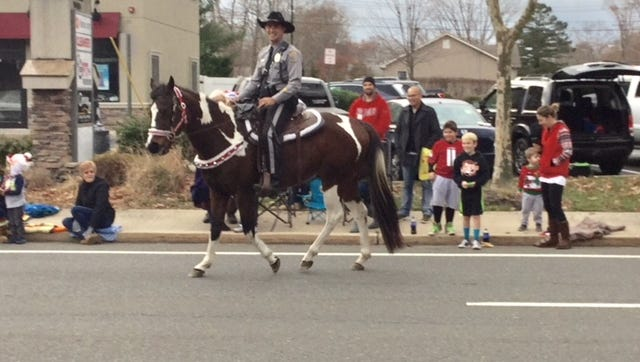 Officer Brian Stockhoff of the Ocean County Sheriff's Department rides Kianti at the Lacey Christmas parade earlier this month.