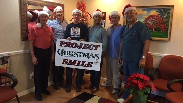 Project Christmas Smile's generous dentists, from left, Dr. Stephen Blank, Dr. R. Craig Cusato, Dr. James Strawn, Dr. Rafael Rodriguez, Dr. John Karpinski, and Dr. Quinton Hedgepeth.