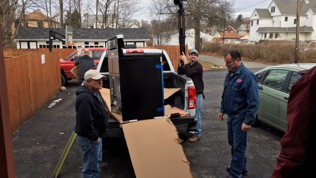 Danny Mapes and Carl Neutzling of the AFL-CIO of Crawford-Richland County unload a stove for the Domestic Violence Shelter of Richland County. The AFL-CIO donated the stove to the United Way agency after learning their stove was no longer working.