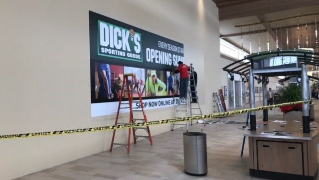 A sign announcing the coming opening of Dick's Sporting Goods goes up in late December at the Foothills shopping center in Midtown Fort Collins.