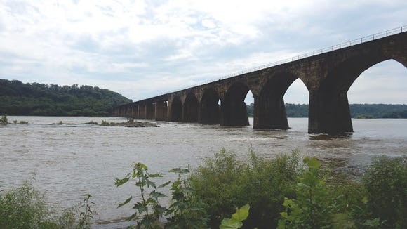 Most Susquehanna River bridges are familiar to motorists, but it takes a biker to show an important but hidden bridge connecting York and Lancaster counties. This is Shock's Mill Bridge, a railroad span, shown from the trail along the Lancaster side. It connects Marietta with Wago Junction, near Saginaw, on the York County side.