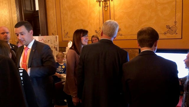 Wood Creek teacher Melissa Cole talks to Michigan Gov. RIck Snyder.
