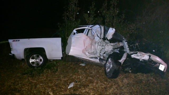 This white pickup truck was one of two vehicles involved in a Sunday morning wreck that left one dead and several injured.