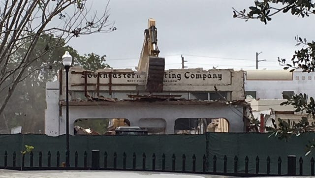Demolition at the Triangle Property site on Dec. 29 reveals the Southeastern Printing Company sign. Back in May 1957, the job printing business and the office supply business became Southeastern Printing Company after Gordon Lockwood bought The Stuart News and the St. Lucie Printing company. Those two businesses were not part of the Lockwood agreement.
