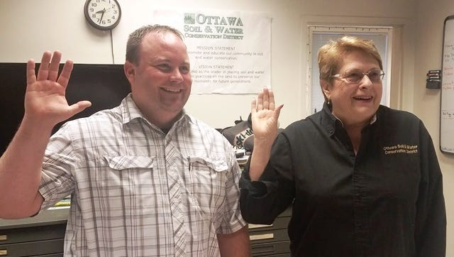 Todd Hecht and Connie Sandwisch are sworn in to the Board of Supervisors of the Ottawa Soil and Water Conservation District.