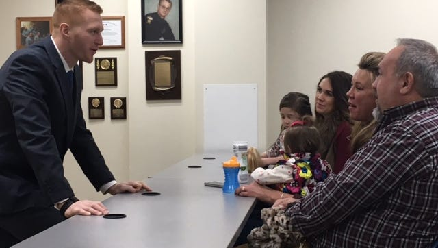 Bradley Gallik, a 2008 graduate of Lexington High School, was sworn in Friday as a probationary police officer with the Mansfield Police Department. Here he talks with his family members.