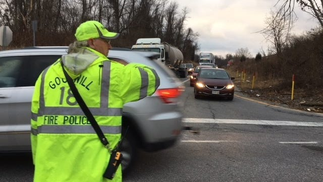 A fire policeman directs traffic at the Glen Rock exit of Interstate 83 after a crash Wednesday, Jan. 24, 2018, closed the northbound lanes. Bill Kalina photo