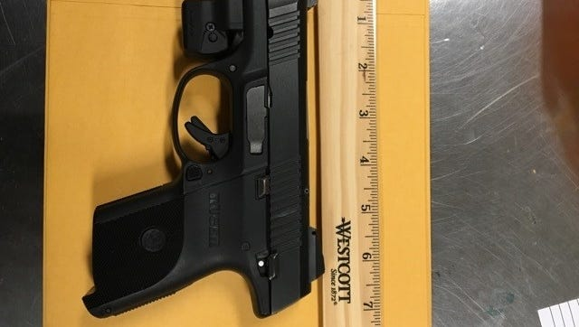 A stolen handgun was found by police during the search of a home belonging to a man who is on probation.