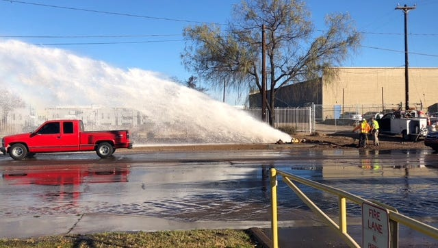 Water streams from where a car struck a fire hydrant on Jan. 29, 2018, near 27th Avenue and Buckeye Road in Phoenix.