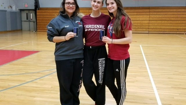 The Pompton Lakes girls fencing epee squad of Paige Rodano, left, Noelle Butera, center, and Jenna Waibel finished third in the District 4 Tournament this past weekend at Fair Lawn High School. Waibel placed first in the individual weapon category.