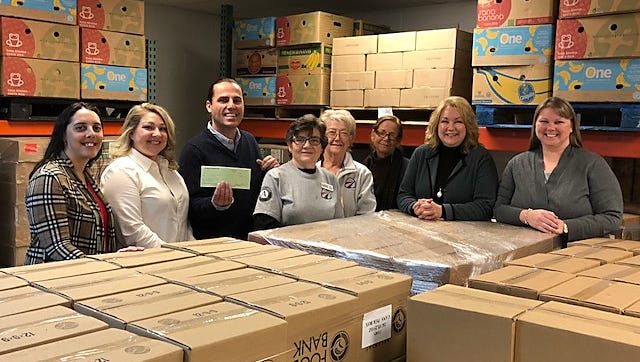 The Gannett Foundation recently presented The Food Bank of North Central Arkansas with a $2,250 grant to assist with an inventory software program that will increase efficiency. Pictured are: (from left)Kendra Spencer, Baxter Bulletin;Adrianne Dunn, Gannett Foundation Representative;Jeff Quick (Food Bank CEO);Janie Austin (DeltaCorps Service Member);Coetia Betarseh (DeltaCorps Service Member);Victoria Moore (Food Bank Operations Director);Shirley Clark (Food Bank Program Officer); andAllison Parks (Food Bank Financial Officer).Through its Community Grant Program, Gannett Foundation supports nonprofit activities in the communities in which Gannett does business. For more information on the Gannett Foundation visit gannettfoundation.org.