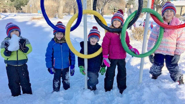 Olympic hopefuls at the Leibham Olympics 2018. From left: Mason, Ty, Harrison, Charlotte, and Lucy Leibham pose by the Olympic rings.