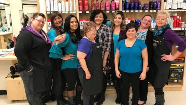 Local JCPenney employees wear purple and turquoise Thursday in remembrance of Cara Marie Loughran, a victim in the Parkland, Florida shooting. Cara was the daughter of a JCPenney salon stylist Denise Loughran.