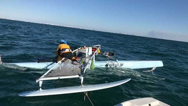Hall of fame sailor Randy Smyth helps to recover his trimaran Synergy on Sunday after the craft capsized on Saturday during the 300-mile Water Tribe Everglades Challenge.