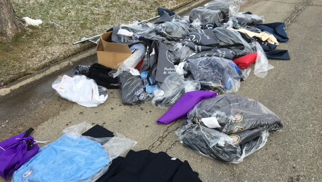 Dry cleaning bags of stolen Farmington Hills and Novi police and fire uniforms recovered from along Outer Drive in Detroit.
