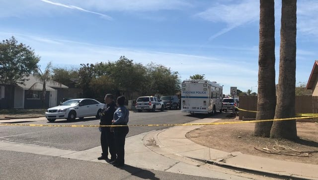 Police tape blocked off the street where officers were involved in a shooting March 9, 2018, near 59th Avenue and Osborn Road in Phoenix.