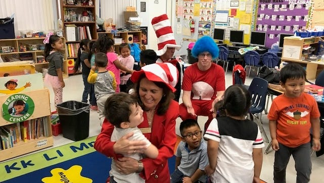 "Students enjoy the Dr. Seuss storytime with Ruth ""Ski"" Pietruszewski, Martin County Tax Collector."