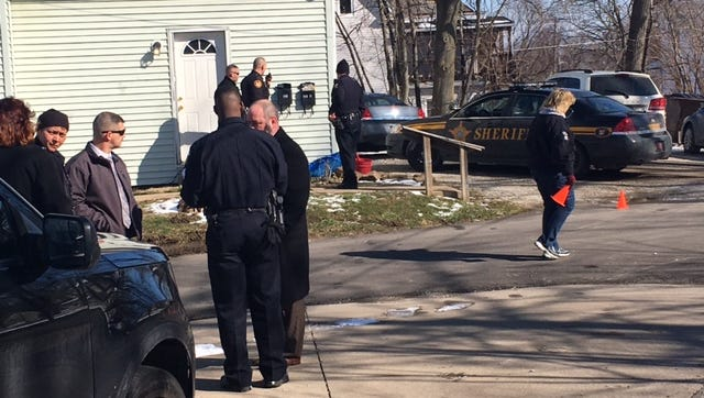 A suspect was arrested Thursday after a man fired shots at a woman in an alley near the Lexington Avenue Advanced Auto Parks. No one was struck, police said.
