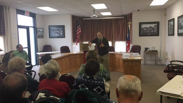 Douglas Dickson, a trustee with the Plymouth Area Historical Society, joined by residents and Council members on Friday gathered at Plymouth Village Hall to witness an independent historic preservation consultant sign a contract to begin her work to get roughly 40 buildings downtown nominated for the National Register of Historic Places.