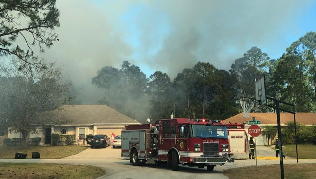 Palm Bay firefighters battled this fire near a residential area of northwest Palm Bay.