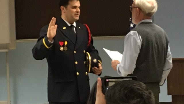 Dan Crow on Tuesday was promoted to the rank of lieutenant at Mansfield Fire Department. Administering the oath of office is Dave Remy, human resources director for the City of Mansfield.