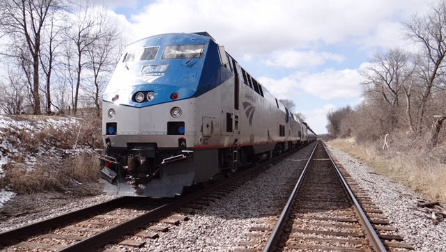 A truck driver was injured Friday afternoon after the truck hit a passenger train in the town of Elba, Dodge County. No one on the train was injured.