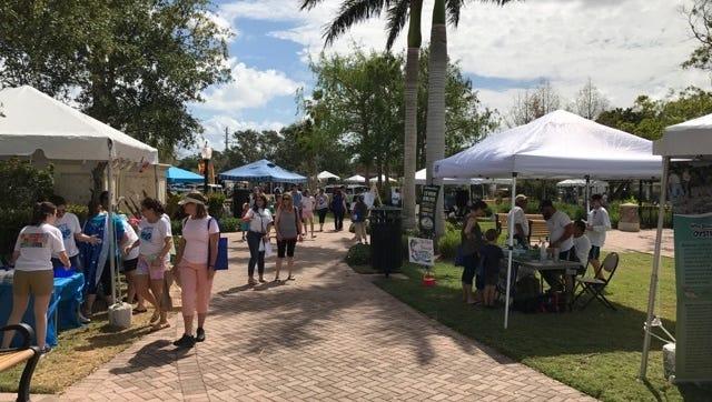 Visitors enjoy Water Fest at Memorial Park in downtown Stuart.