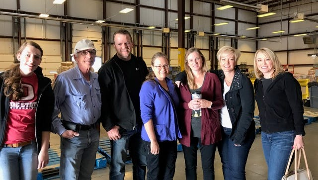 Members of the symphony donate their time to help at the Utah Food Bank.