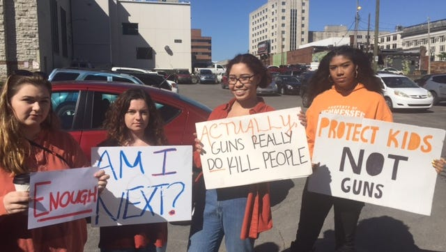 Students walk out of Hume-Fogg Academic Magnet School