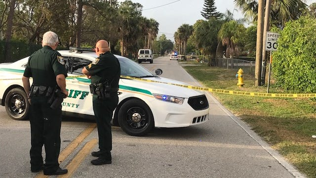 Lee County Sheriff's Office deputies guard a section of Matheson Avenue in Bonita Springs where a homicide occurred late Saturday night. No details were available.