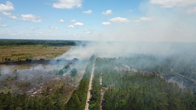 Smoke and flames seen near Garcon Point Wednesday were a controlled burn, according to the Florida Forest Service.