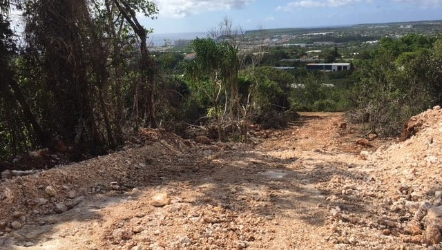 A rough road cleared by the Department of Public Works on Chamorro Land Trust property in Barrigada Heights, as seen April 25, 2018. Hundreds of yards of roadway has been created, but without necessary government permits, stalling the project.