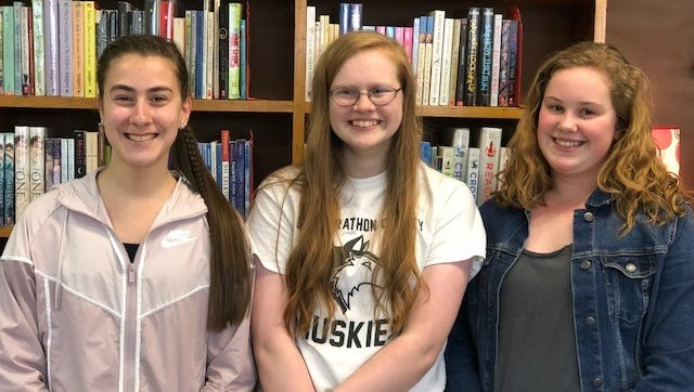 From left, Kiara Hammond, Katie Kloth and Haley Rick were honored April 21 in Green Bay for their letters to authors in the Letters About Literature contest.