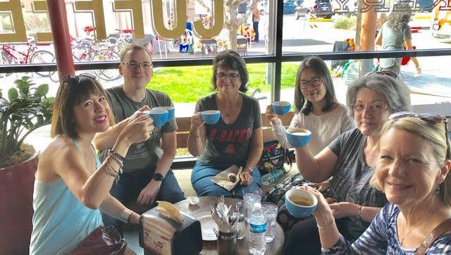 Attendees enjoy coffee on the Downtown Phoenix Coffee Crawl by Phoenix Rising Tours Jill Johnson.
