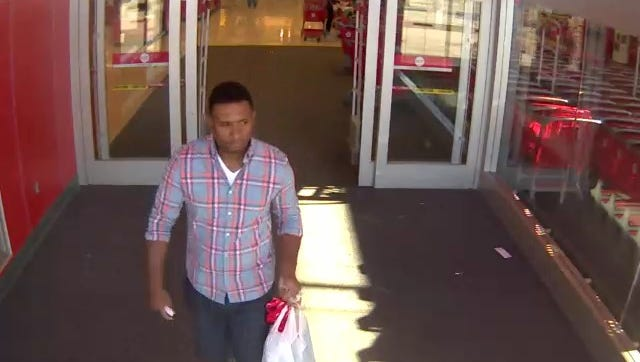 A man leaves a store after stealing two 512GB black iPad Pros at 5:45 p.m. May 6 at Target, 12725 W. Bluemound Road.