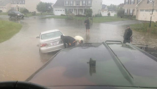 The Berlin Police Department rescues stranded motorists during Friday's flooding.