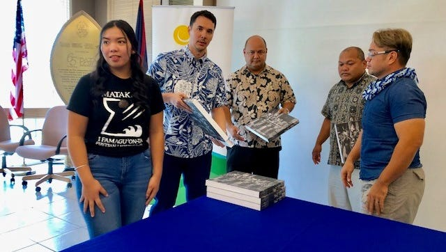 Guam Visitors Bureau President Nathan Denight, second from left, on Wednesday leads the donation to public schools of 50 copies of Pulitzer Prize-winning photographer Manny Crisostomo's book which captures stunning images from the 2016 Festival of the Pacific Arts that Guam hosted.