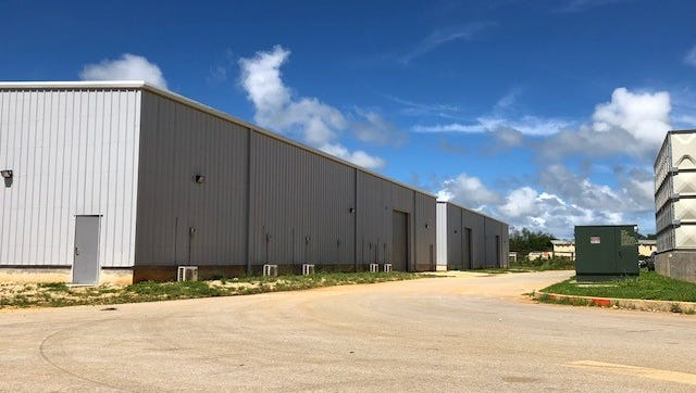 After a nearly two-year construction and permitting delay, two new warehouses and a new two-story building could finally be used as Guam Department of Education central offices at Tiyan by June.